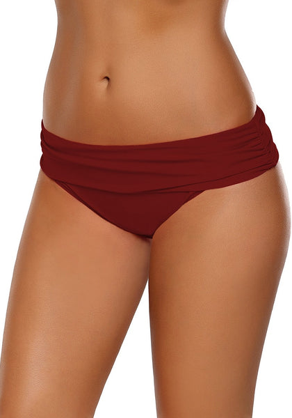 Left angled view of model in red shirred waistband swim bottom