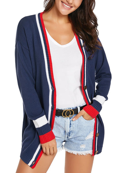 Model poses wearing navy blue striped trim button-up knit cardigan