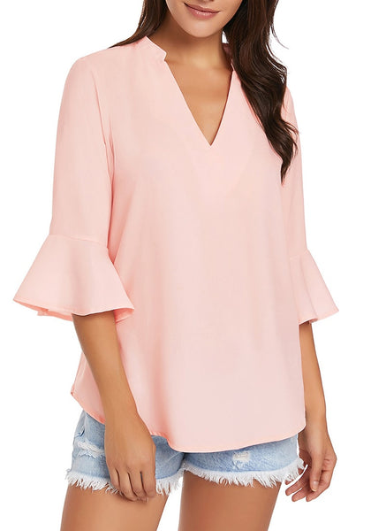Model wearing light pink V-neck flare sleeves loose chiffon blouse