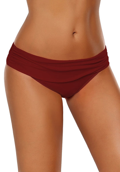 Right angled shot of model wearing red shirred waistband swim bottom