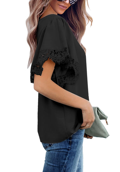 Side view of model wearing black flutter sleeves lace trim loose blouse