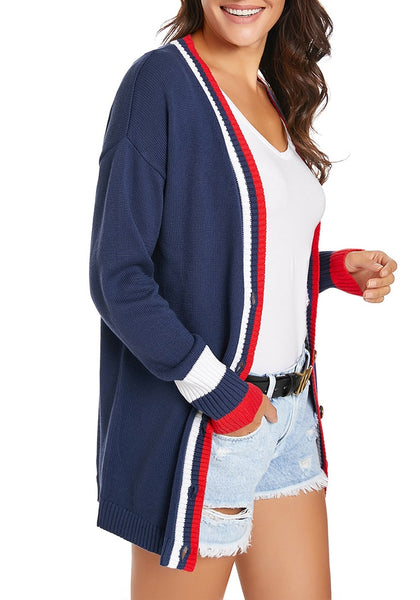 Side view of model wearing navy blue striped trim button-up knit cardigan