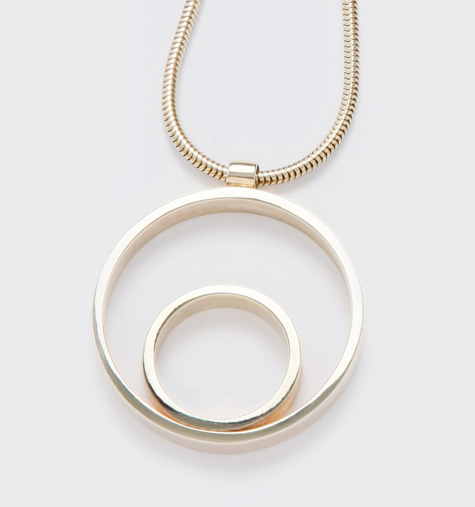 Circles Large Gold Pendant. Material: 9ct yellow gold. Measurements: 41mm outside diameter. Design Year: 2006