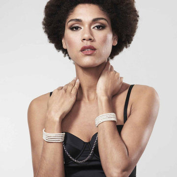 Woman wearing Plasir Nacré · Pearl Handcuffs by Bijoux Indiscrets