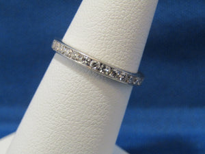 14KT ROUND DIAMOND ETERNITY BAND....2.4MM WIDE.... .84TCW.