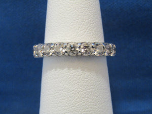 14KT ROUND DIAMOND WEDDING BAND...INSIDE SET PRONG DESIGN .90CTS