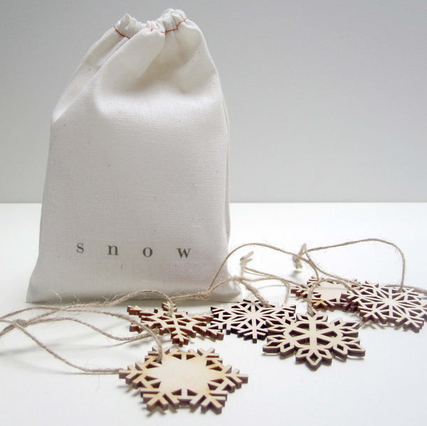 bag of wooden snowflakes