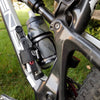 Wolf Tooth half bottle mount on dual suspension bike