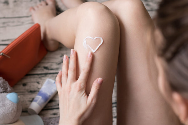 leg with heart drawn with moisturizer