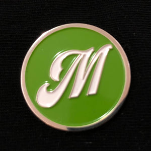 "Enamel pin - ""M"" Silver - white on green"