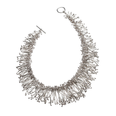 Hundreds of silver strands are intricately connected to create this extravagant choker necklace. Designed and handmade by Yen Jewellery