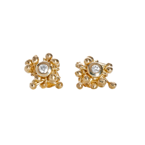 18ct gold and diamond cluster stud earrings. Gold elements surround a central diamond. Handmade by Yen Jewllery