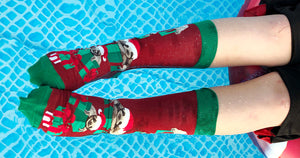 Sloth Christmas socks for Christmas in July, worn in the pool!