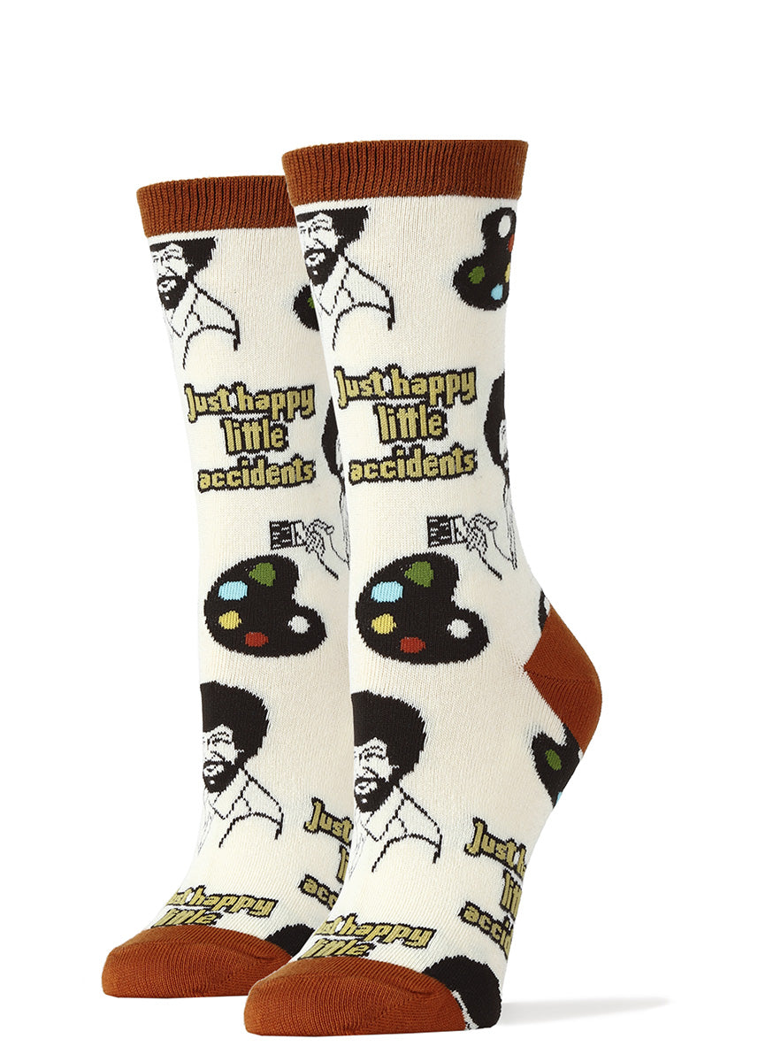 "Bob Ross socks for women with painter's palettes and the words ""just happy little accidents."""