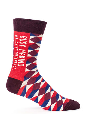 "Funny men's ""Busy making a fucking difference"" socks with swear words on a red background"