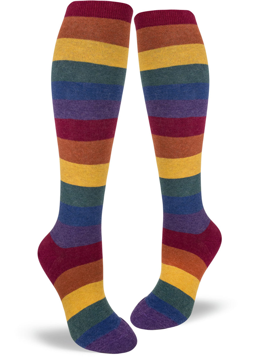 Knee-high rainbow socks with muted colored rainbow stripes