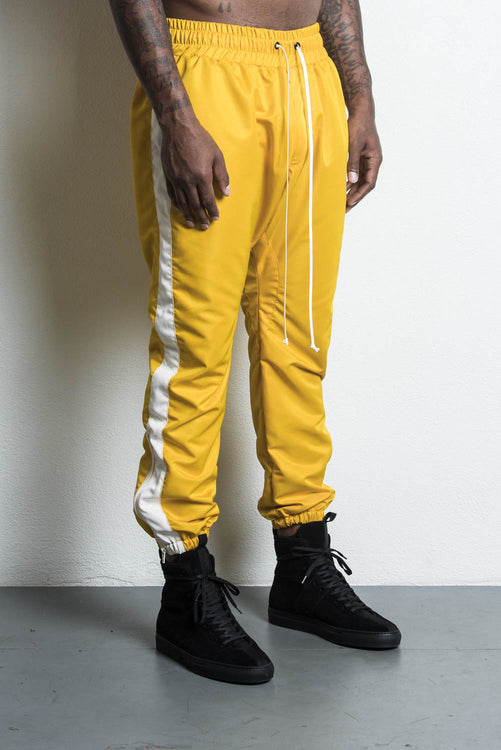 parachute track pant in yellow/ivory by daniel patrick