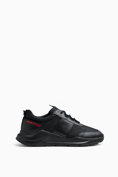 panel runner sneaker in black/red by daniel patrick
