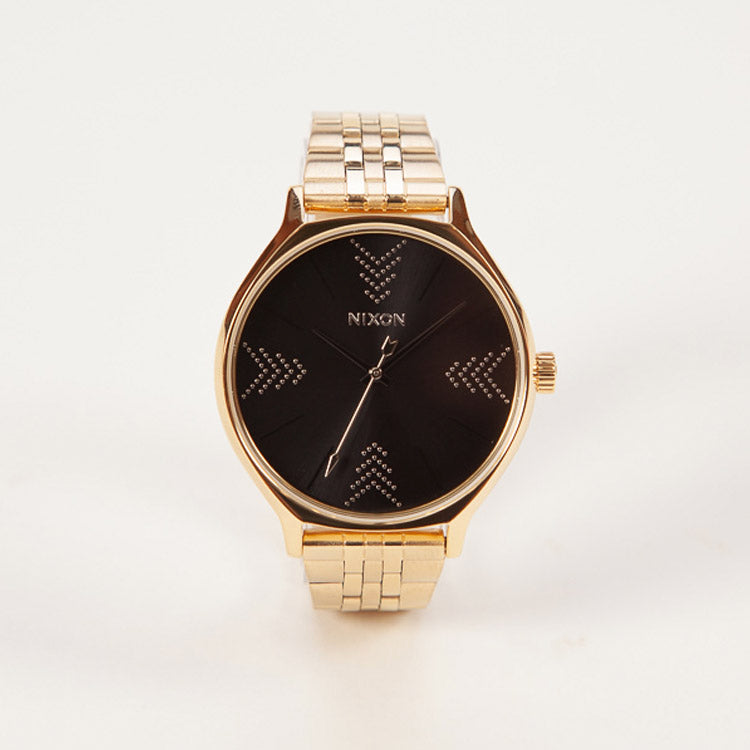 Product shot: Nixon Clique Gold / Black / Silver Watch
