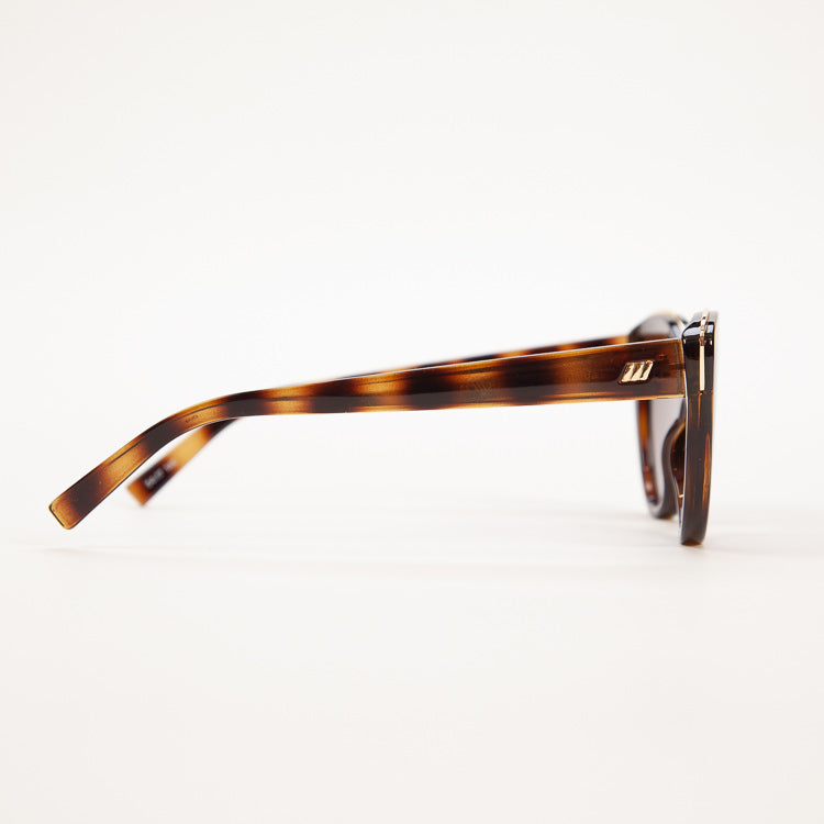 Detail shot: Le Specs Beautiful Stranger Tort Sunglasses