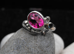 Bright pink oval ring