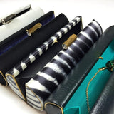 Ginny: Black Duchess Roll Clutch - AMANDA PEARL