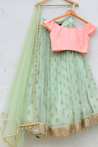 Mint Green Lehenga With Peach Pink Blouse
