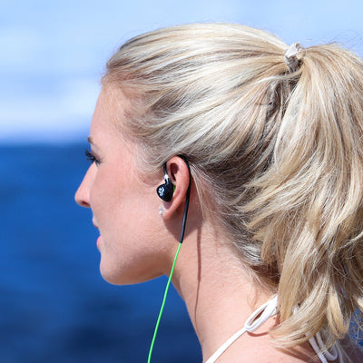 Woman Wearing Black and Green Fit 2.0 Sport Earbuds