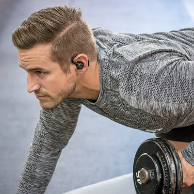 Man Lifting Weights Wearing Black Epic Air True Wireless Earbuds