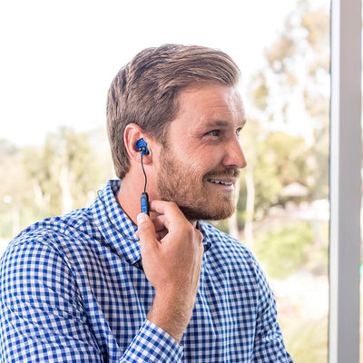 Guy wearing Metal Bluetooth Rugged Earbuds in blue