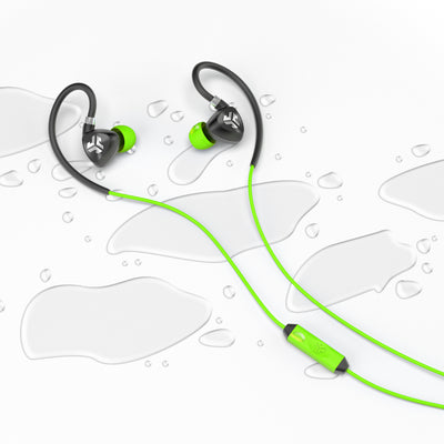 Flat Lay of Black and Green Fit 2.0 Sport Earbuds in Water Drops