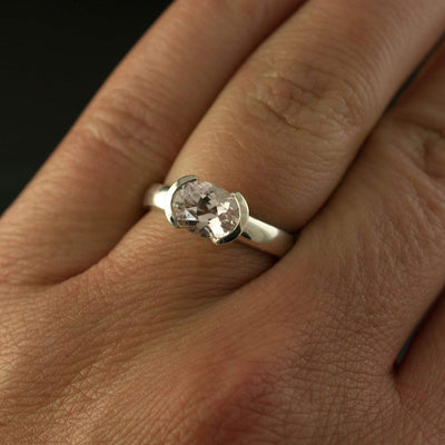 oval morganite engagement ring on hand
