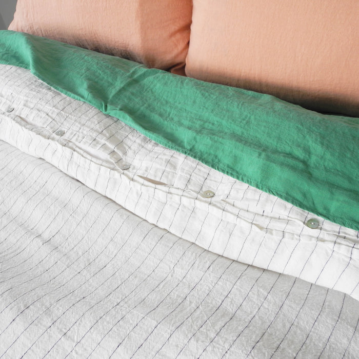 A Linge Particulier Linen Duvet in Tennis Stripe gives a white and black stripe color to this duvet for a colorful patterned and printed linen bedding look from Collyer's Mansion