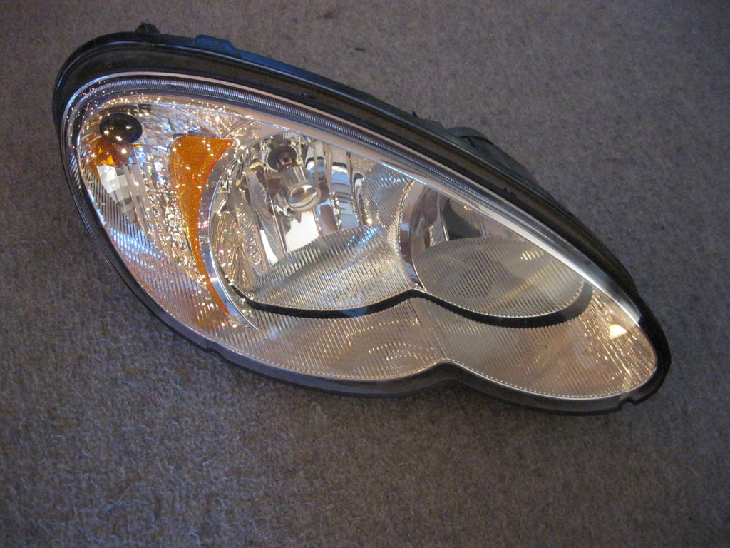 06-09 PT CRUISER PASSENGERS SIDE HEADLIGHT AFTERMARKET