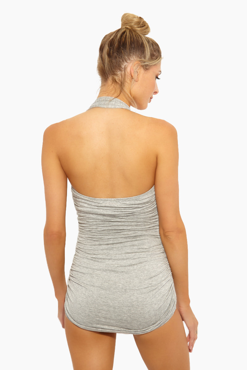 NORMA KAMALI Bill Mio Halter Sweetheart Neckline One Piece Swimsuit - Light Grey One Piece | Light Grey| Norma Kamali Bill Mio Halter Sweetheart Neckline One Piece Swimsuit - Light Grey Features:  Halter strap one piece  Sweetheart neckline Great for curves Shirred sides High cut leg Full bottom coverage Wrinkle free Back View