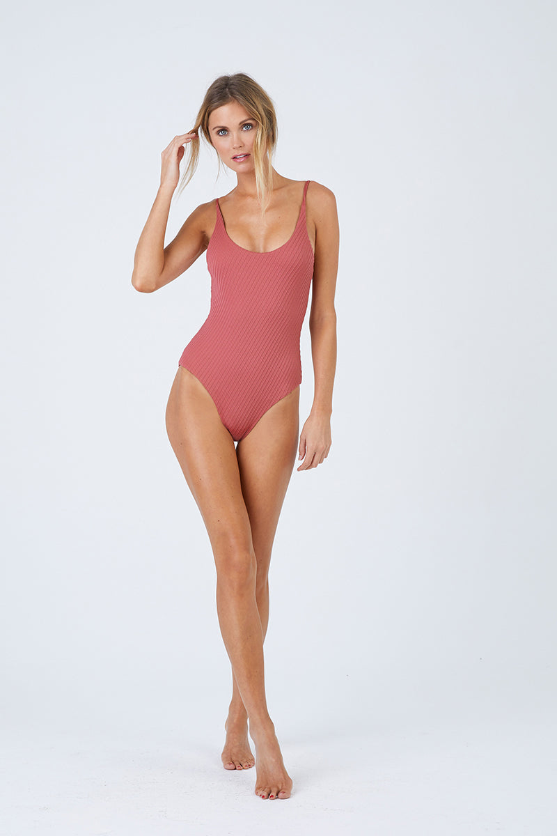 FELLA Zac Strappy Back One Piece Swimsuit - Spice One Piece   Spice Zac One Piece Features:  Italian Textured Lycra Round neckline with thin straps that cross over at the back Perfect to wear from day to night as a bodysuit under shorts or a skirt Cheeky bum Fits true to size
