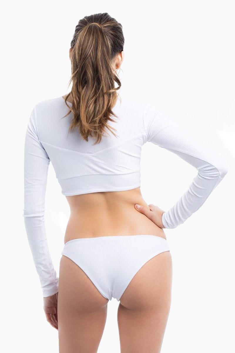ELLE MER Sandbar High Neck Ribbed Long Sleeve Cropped Rashguard - White Bikini Top | White|Sandbar Rashguard - Features:  Three panel design Invisible lining over bust panel Tapered longsleeves SPF 50 protection Cropped style