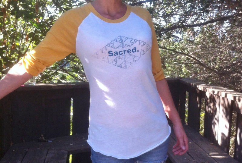 Sacred.  Yellow and White Baseball Tee