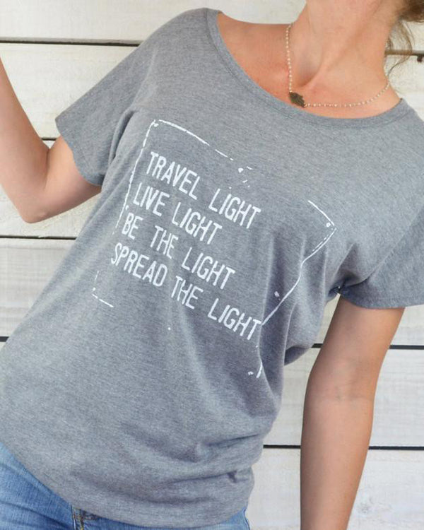 Travel Light, ...Spread The Light. Grey Wide Neck Tee