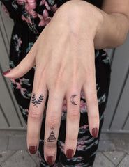 tiny tattoo - symbols on hands