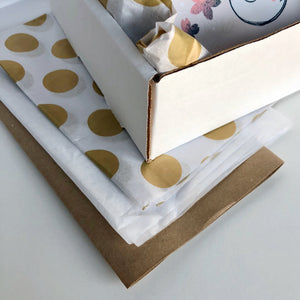 Curated care package with cute, inspirational gifts from Ao (gold wrapping theme)