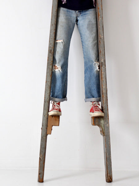 antique wooden stilts