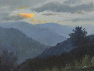 Landscape painting of a dusk scene. Mountains are of varying shades of dark blue and a cloud is lit with yellow orange light of the setting sun.