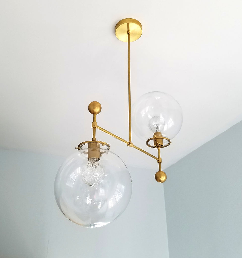 large glass globe and brass ball chandelier ceiling fixture raw brass mid century dining room light fixture