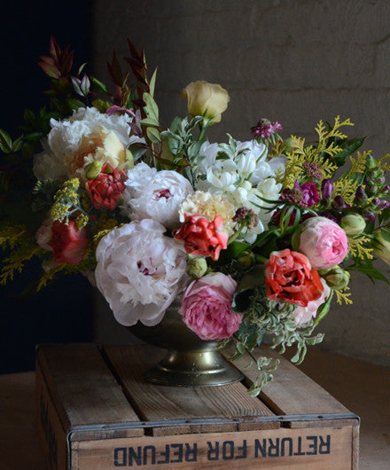 Centerpiece in recycled footed urn by Tin Can Studios.