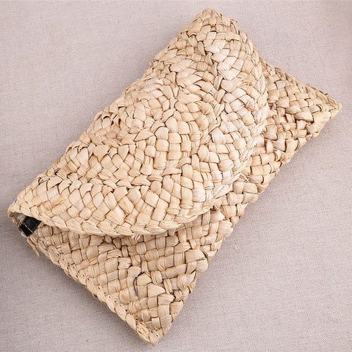 Straw Clutch. STYLE TIP - Layer with gold fine bracelets. Casual, elegant.