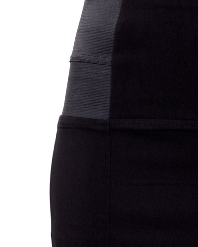 Black high waisted stretch skirt showing side elastic detail
