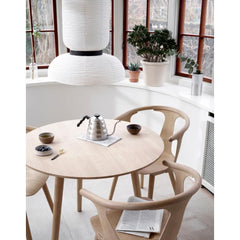 And Tradition JH3 Formakami Pendant Light in room with In Between Chairs and Hoof Table