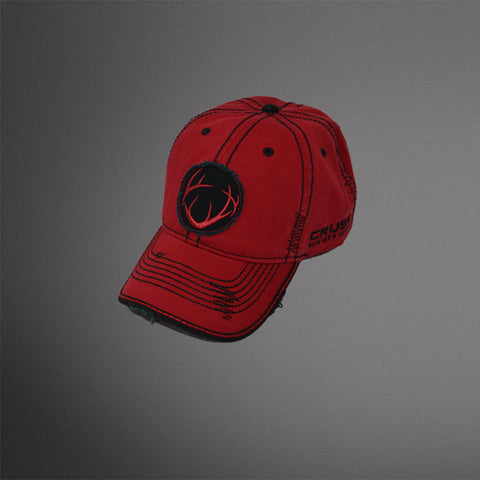 Red distressed cap with black frayed circle antler patch