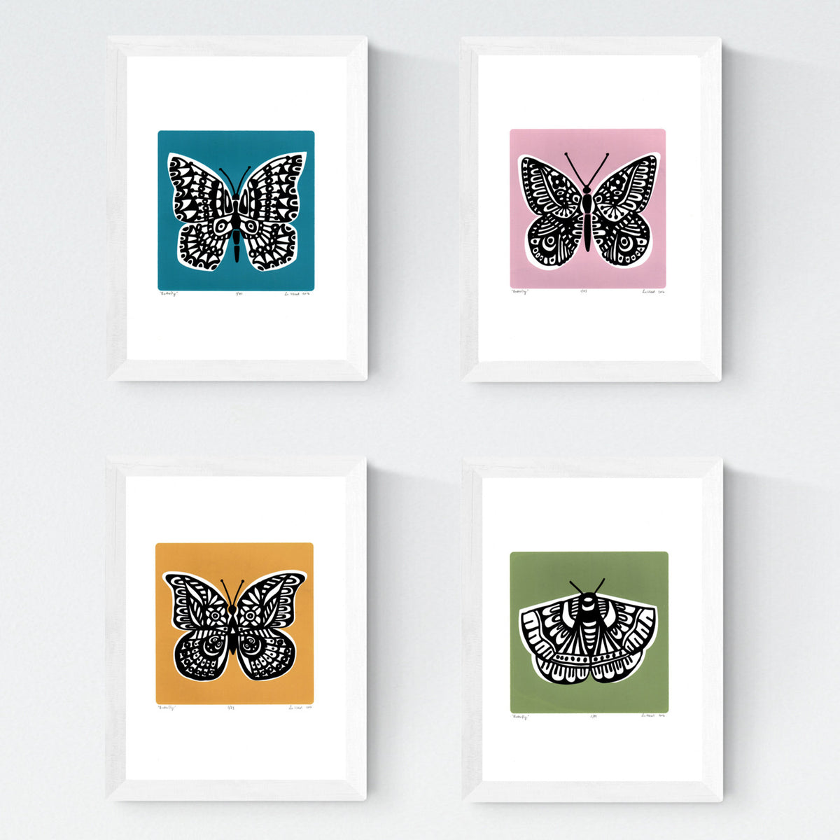 Set of 4 framed limited edition Butterfly silkscreen prints in slate teal, powder pink, saffron yellow and sage green. Illustrated in a simple, Scandinavian style and printed by hand.